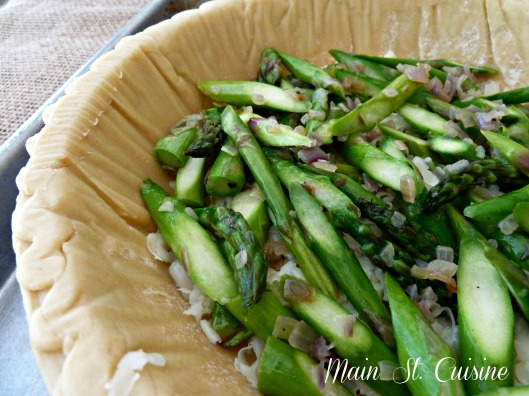 asparagus in a prepared pie shell
