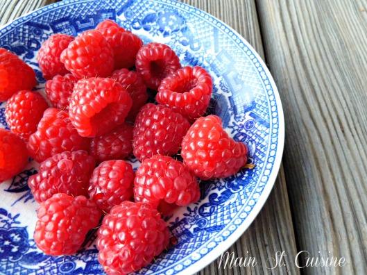 adding fresh raspberries to french toast